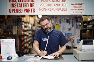 Bluflame technician taking phone order for retail HVAC parts